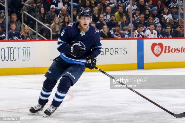 Patrik Laine of the Winnipeg Jets keeps an eye on the play during first period action against the Colorado Avalanche at the Bell MTS Place on...