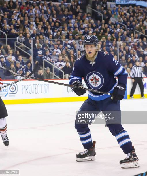 Patrik Laine of the Winnipeg Jets keeps an eye on the play during second period action against the Arizona Coyotes at the Bell MTS Place on February...