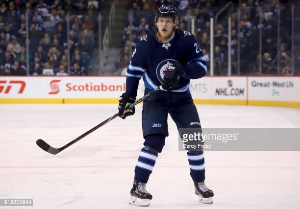 Patrik Laine of the Winnipeg Jets keeps an eye on the play during first period action against the New York Rangers at the Bell MTS Place on February...