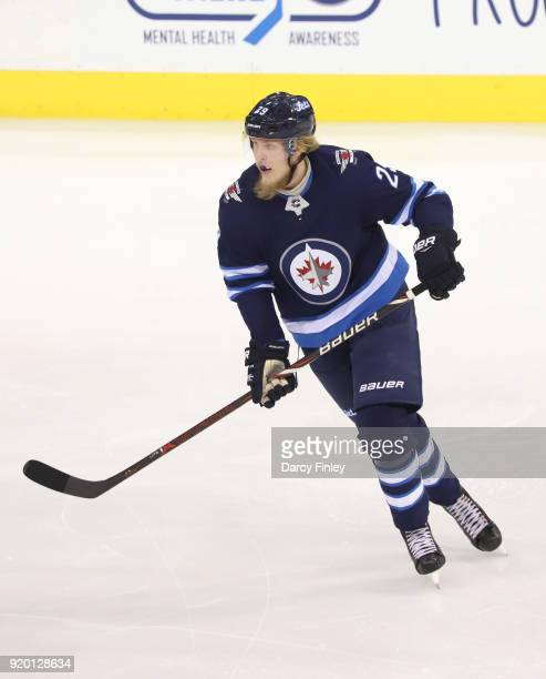 Patrik Laine of the Winnipeg Jets keeps an eye on the play during third period action against the Washington Capitals at the Bell MTS Place on...
