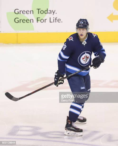 Patrik Laine of the Winnipeg Jets keeps an eye on the play during first period action against the Washington Capitals at the Bell MTS Place on...