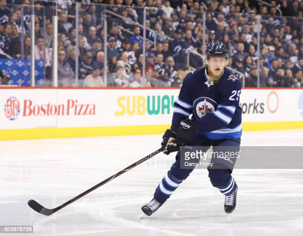 Patrik Laine of the Winnipeg Jets keeps an eye on the play during second period action against the Los Angeles Kings at the Bell MTS Place on...