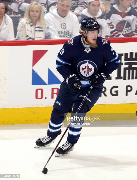 Patrik Laine of the Winnipeg Jets keeps an eye on the play during second period action against the Minnesota Wild in Game Two of the Western...