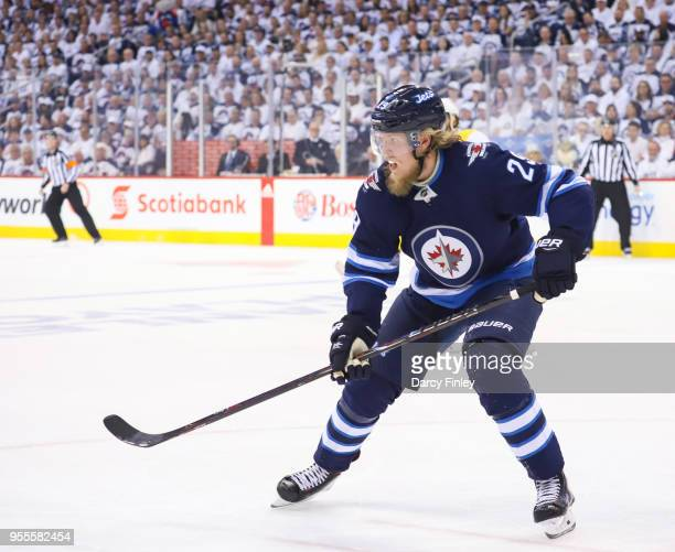 Patrik Laine of the Winnipeg Jets keeps an eye on the play during first period action against the Nashville Predators in Game Four of the Western...