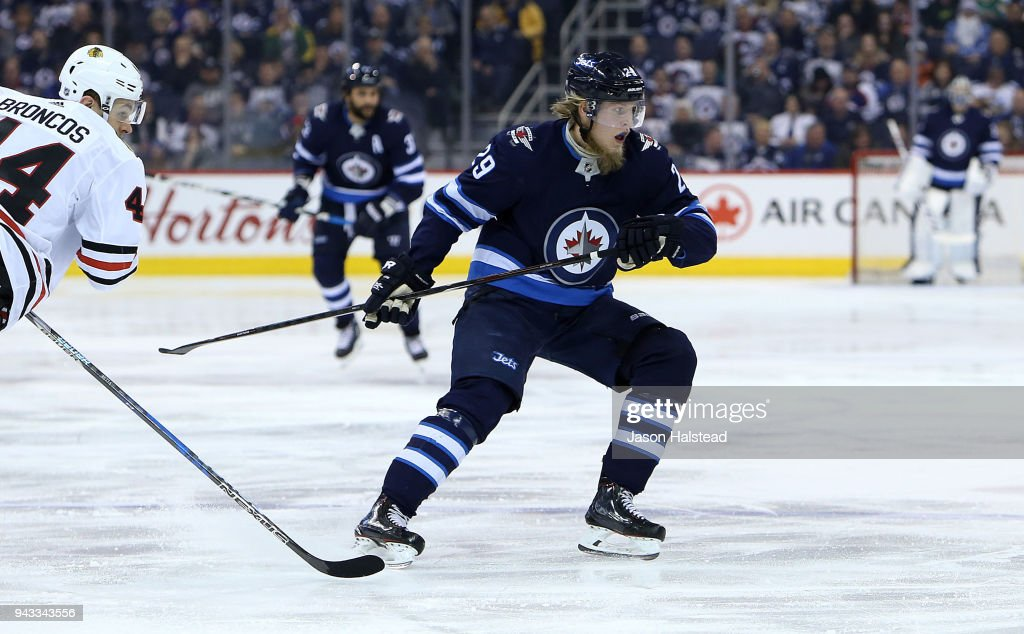 Patrik Laine #29 of the Winnipeg Jets looks for the puck during NHL action against the Chicago Blackhawks on April 7, 2018 at Bell MTS Place in Winnipeg, Manitoba.
