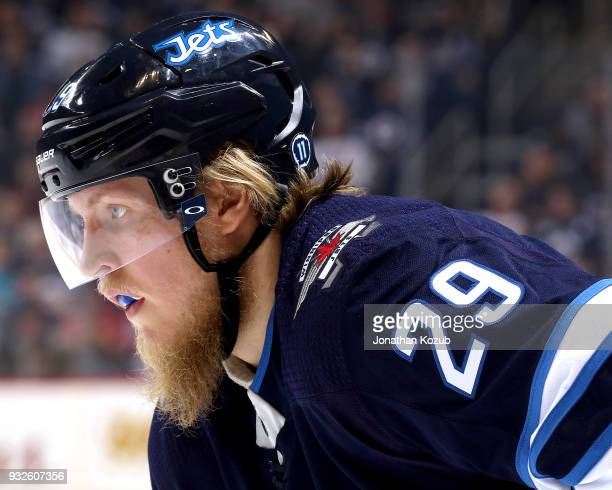 Patrik Laine of the Winnipeg Jets looks on during a second period faceoff against the Chicago Blackhawks at the Bell MTS Place on March 15 2018 in...