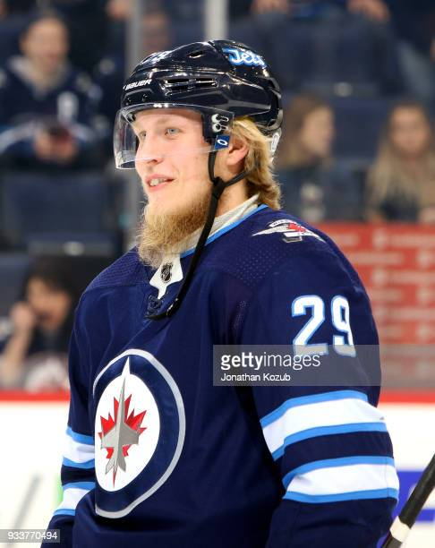 Patrik Laine of the Winnipeg Jets looks on during the pregame warm up prior to NHL action against the Dallas Stars at the Bell MTS Place on March 18...