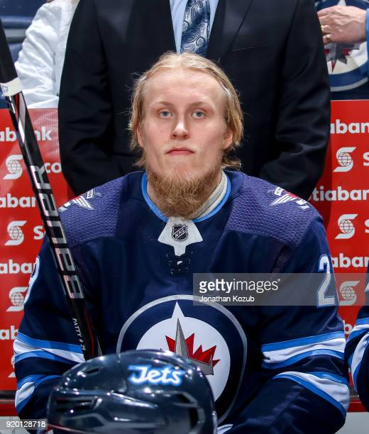 Patrik Laine of the Winnipeg Jets looks on from the bench prior to puck drop against the Washington Capitals at the Bell MTS Place on February 13...