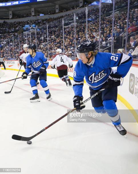 Patrik Laine of the Winnipeg Jets plays the puck along the boards during first period action against the Colorado Avalanche at the Bell MTS Place on...
