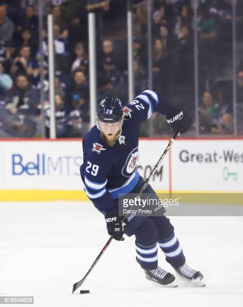 Patrik Laine of the Winnipeg Jets plays the puck down the ice during first period action against the Arizona Coyotes at the Bell MTS Place on...