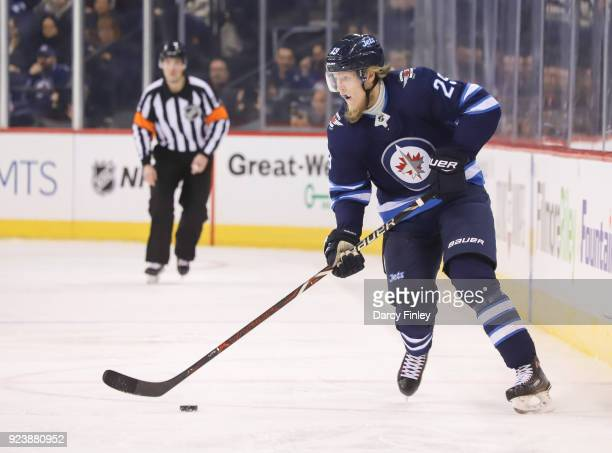 Patrik Laine of the Winnipeg Jets plays the puck down the ice during third period action against the Los Angeles Kings at the Bell MTS Place on...