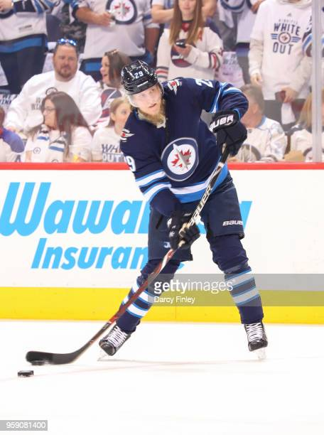 Patrik Laine of the Winnipeg Jets plays the puck during first period action against the Vegas Golden Knights in Game One of the Western Conference...