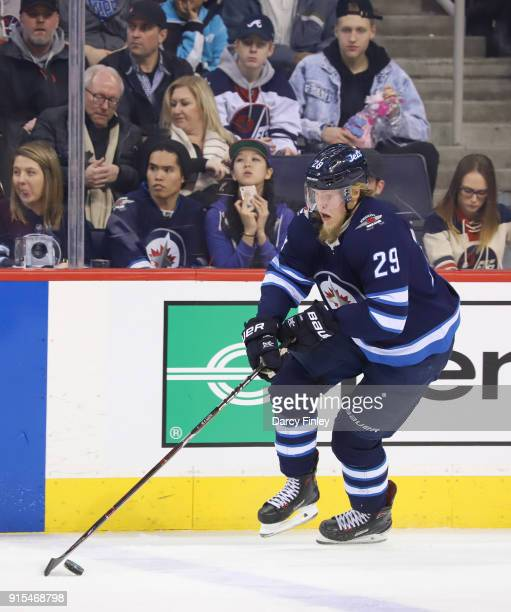 Patrik Laine of the Winnipeg Jets plays the puck up the ice during second period action against the Colorado Avalanche at the Bell MTS Place on...