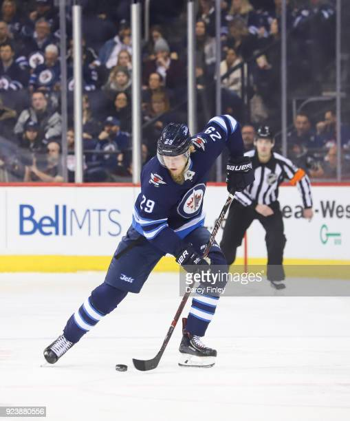 Patrik Laine of the Winnipeg Jets plays the puck up the ice during third period action against the Los Angeles Kings at the Bell MTS Place on...
