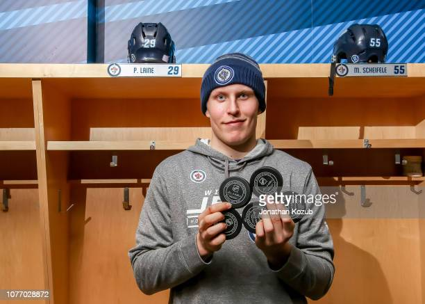 Patrik Laine of the Winnipeg Jets poses with the game pucks that he scored a career high fivegoal night on November 24 2018 against the St Louis...