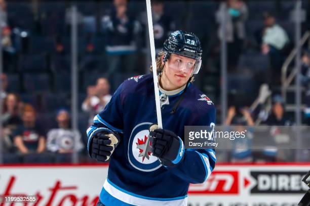 Patrik Laine of the Winnipeg Jets salutes the fans after receiving first star honours following a 5-2 victory over the Ottawa Senators at the Bell...