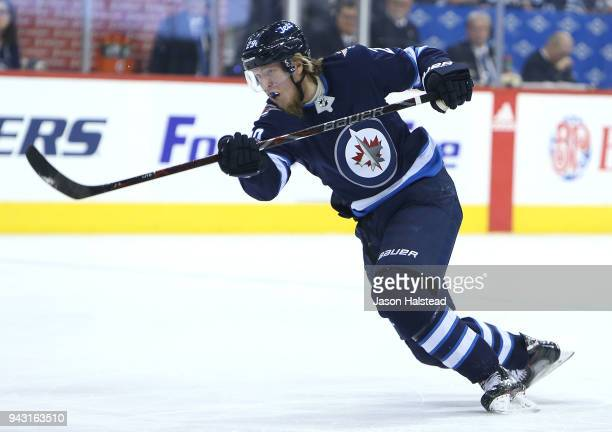 Patrik Laine of the Winnipeg Jets shoots against the Chicago Blackhawks during NHL action on April 7 2018 at Bell MTS Place in Winnipeg Manitoba