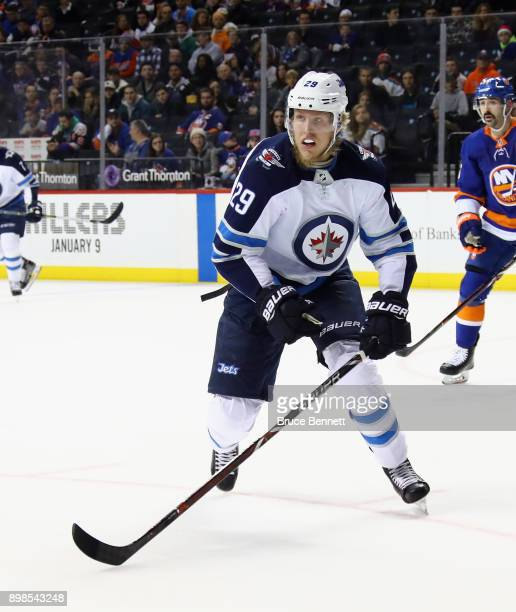 Patrik Laine of the Winnipeg Jets skates against the New York Islanders at the Barclays Center on December 23 2017 in the Brooklyn borough of New...