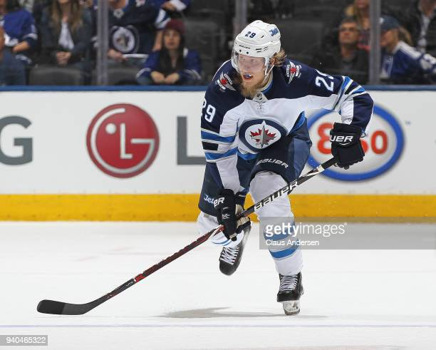 Patrik Laine of the Winnipeg Jets skates against the Toronto Maple Leafs during an NHL game at the Air Canada Centre on March 31 2018 in Toronto...