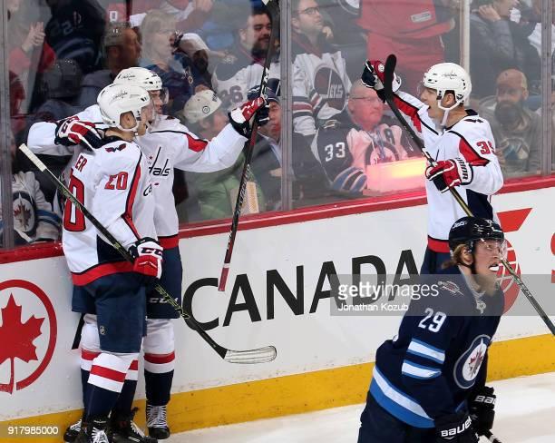 Patrik Laine of the Winnipeg Jets skates away as Lars Eller Andre Burakovsky and Alex Chiasson of the Washington Capitals celebrate a second period...
