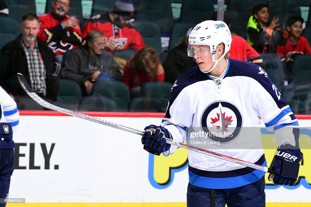 Patrik Laine #29 of the Winnipeg Jets skates in the warmup before an NHL game against the Calgary Flames on December 10, 2016 at the Scotiabank Saddledome in Calgary, Alberta, Canada.