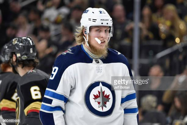 Patrik Laine of the Winnipeg Jets skates to the bench in Game Three of the Western Conference Final against the Vegas Golden Knights during the 2018...