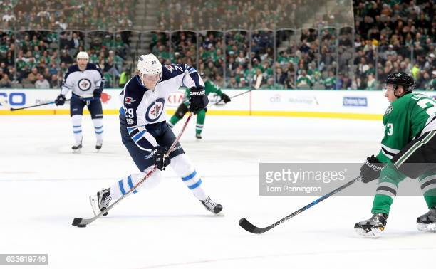 Patrik Laine of the Winnipeg Jets takes a shot on goal against Esa Lindell of the Dallas Stars in the second period at American Airlines Center on...