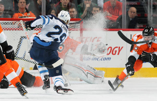 Patrik Laine of the Winnipeg Jets takes a shot on goal against the Philadelphia Flyers on March 10, 2018 at the Wells Fargo Center in Philadelphia,...