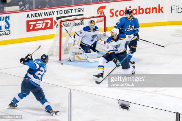 Patrik Laine of the Winnipeg Jets takes a shot towards goaltender Jake Allen of the St Louis Blues during second period action at the Bell MTS Place...