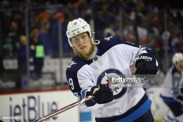 Patrik Laine of the Winnipeg Jets takes the shot in warm ups prior to the game against the New York Islanders at the Barclays Center on December 23...