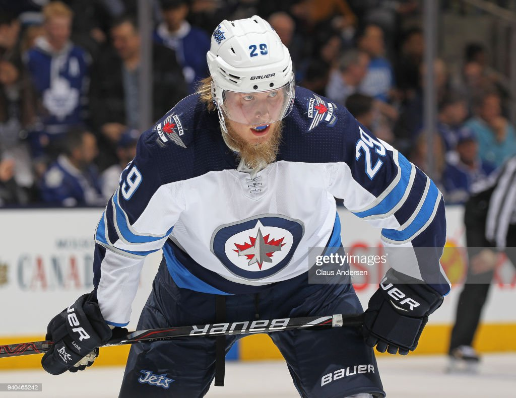 Patrik Laine #29 of the Winnipeg Jets waits for play to resume against the Toronto Maple Leafs during an NHL game at the Air Canada Centre on March 31, 2018 in Toronto, Ontario, Canada. The Jets defeated the Maple Leafs 3-1.