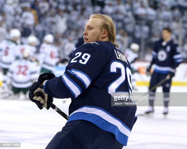 Patrik Laine of the Winnipeg Jets warms up before action against the Minnesota Wild in Game One of the Western Conference First Round during the 2018...