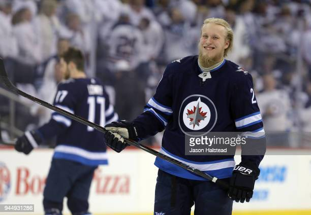 Patrik Laine of the Winnipeg Jets warms up prior to Game One of the Western Conference First Round during the 2018 NHL Stanley Cup Playoffs against...