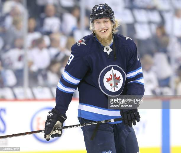 Patrik Laine of the Winnipeg Jets warms up prior to Game Two of the Western Conference First Round during the 2018 NHL Stanley Cup Playoffs against...