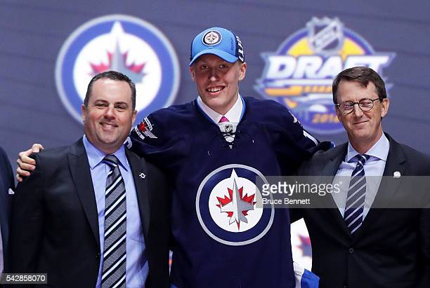 Patrik Laine reacts after being selected second overall by the Winnipeg Jets during round one of the 2016 NHL Draft on June 24, 2016 in Buffalo, New...