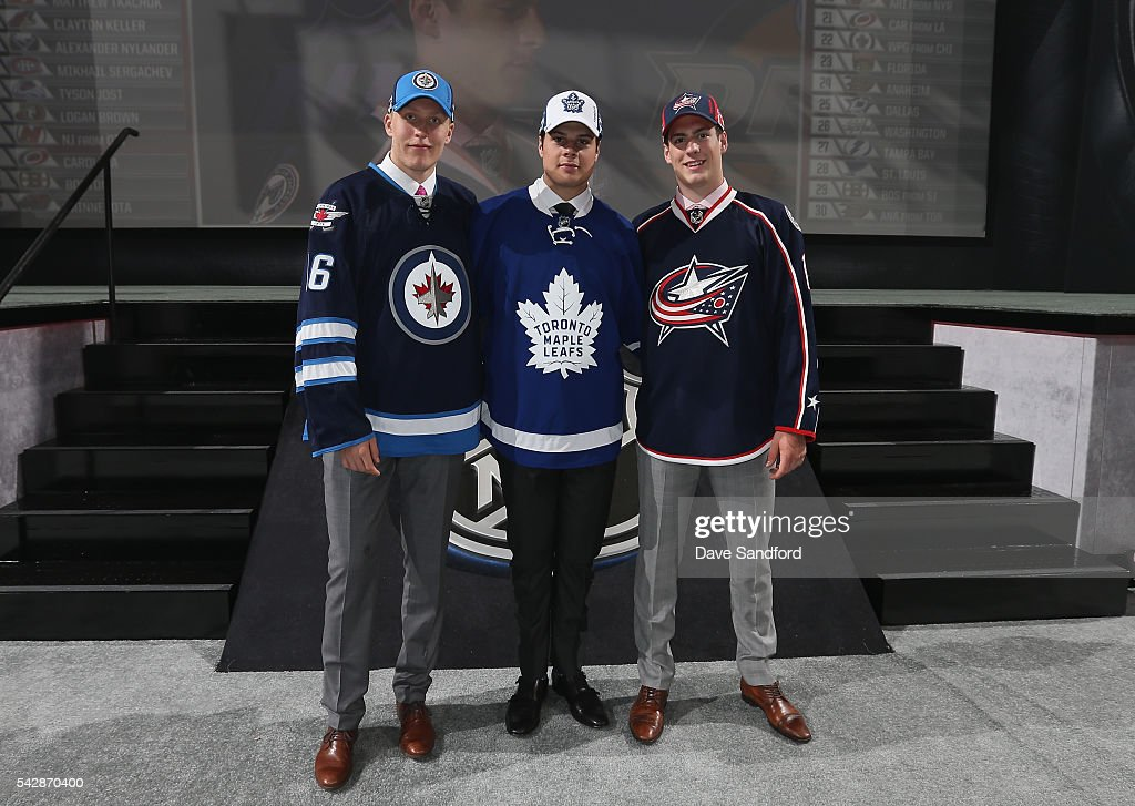 Patrik Laine, selected second overall by the Winnipeg Jets, Auston Matthews, selected first overall by the Toronto Maple Leafs, and Pierre-Luc Dubois, selected third overall by the Columbus Blue Jackets, stand onstage during round one of the 2016 NHL Draft at First Niagara Center on June 24, 2016 in Buffalo, New York.