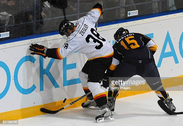 Patrik Lostedt of Espoo Blues and Thomas Ziegler of Bern fight for the puck during the IIHF Champions Hockey League match between Espoo Blues and SC...