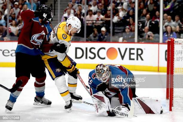 Patrik Nemeth and goalie Andrew Hammond of the Colorado Avalanche prevent a shot on goal by Viktor Arvidsson of the Nashville Predators in Game Six...
