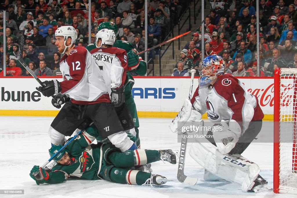 Patrik Nemeth #12, David Warsofsky #5, and goalie Semyon Varlamov #1 of the Colorado Avalanche defend against Daniel Winnik #26 and Marcus Foligno #17 of the Minnesota Wild during the game at the Xcel Energy Center on March 13, 2018 in St. Paul, Minnesota.