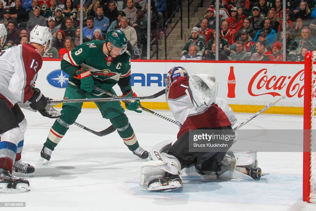 Patrik Nemeth #12 defends as his teammates goalie Semyon Varlamov #1 of the Colorado Avalanche makes a save against Mikko Koivu #9 of the Minnesota Wild during the game at the Xcel Energy Center on March 13, 2018 in St. Paul, Minnesota.