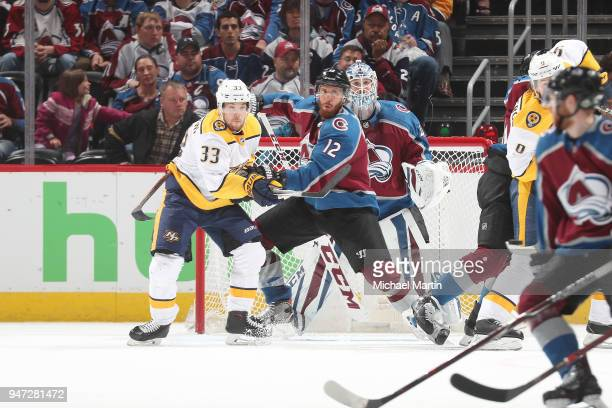 Patrik Nemeth of the Colorado Avalanche fights for position against Viktor Arvidsson of the Nashville Predators in front of goaltender Jonathan...