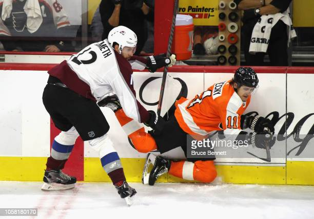 Patrik Nemeth of the Colorado Avalanche hits Travis Konecny of the Philadelphia Flyers during the third period at the Wells Fargo Center on October...