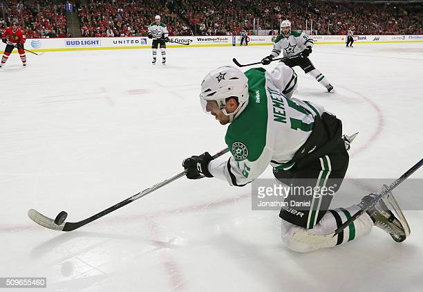 Patrik Nemeth of the Dallas Stars passes from his knees against the Chicago Blackhawks at the United Center on February 11, 2016 in Chicago, Illinois.