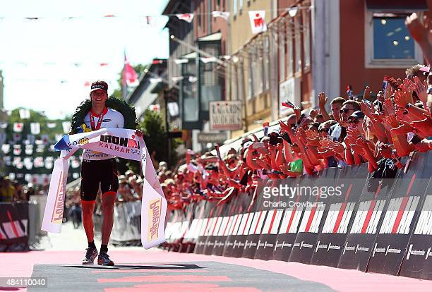 Patrik Nilsson of Sweden celebrates after winning the mens race during Ironman Kalmar on August 15 2015 in Kalmar Sweden