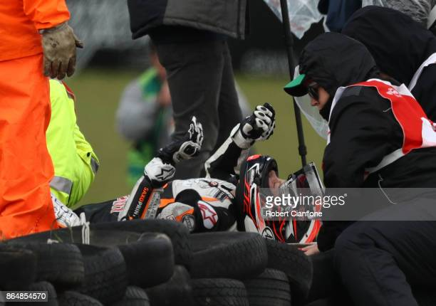 Patrik Pulkkinen of Finland and rider of the Peugeot Saxopoint Peugeot is treated by medical staff after crashing during the Moto3 race at the 2017...