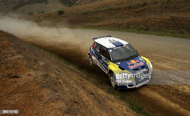 Patrik Sandell and codriver Emil Axelson of Sweden drive their Skoda Fabia S2000 during stage 12 of the WRC Rally of New Zealand on the Te Akau Coast...