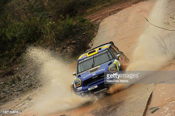 Patrik Sandell of Sweden and Maria Andersson of Sweden compete in their Prodrive WRC Team Mini John Cooper Works WRC during day one of the FIA World...