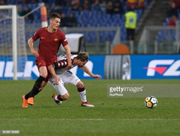 Patrik Schick and Cristian Ansaldi during the Italian Serie A football match between AS Roma and FC Torino at the Olympic Stadium in Rome on march 09...