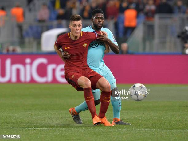 Patrik Schick and Samuel Umtiti during the UEFA Champions League quarter final match between AS Roma and FC Barcelona at the Olympic stadium on April...