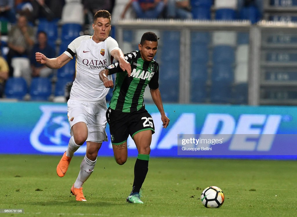 Patrik Schick of AS Roma and Rogerio of US Sassuolo in action during the serie A match between US Sassuolo and AS Roma at Mapei Stadium - Citta' del Tricolore on May 20, 2018 in Reggio nell'Emilia, Italy.